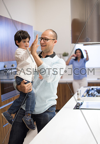 Young middle east father and son happily spend time in the kitchen