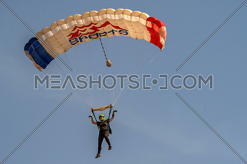 Some Athletes practice skydiving and air sport in the desert