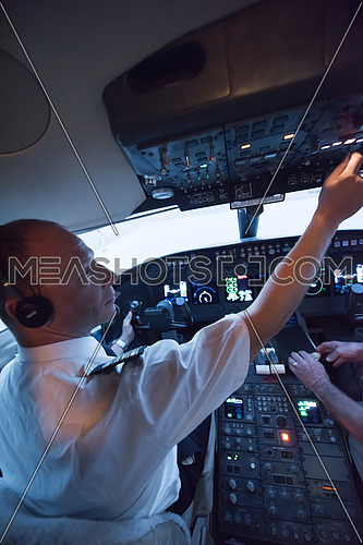 Portrait of a young middle eastern successful pilot in the cockpit