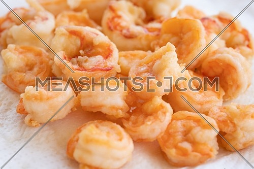peeled fried prawns isolated on white background close up