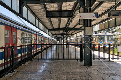 Interior shot of Haydarpasha Railway Terminal featuring metal truss and two colored empty trains, Kadikoy, Istanbul, Turkey, built 1909, closed in 2013 due to the rehabilitation of Marmaray line