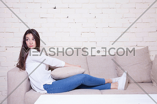 A girl sitting on couch
