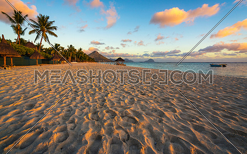 Flic and flac beach at sunset in Mauritius island.