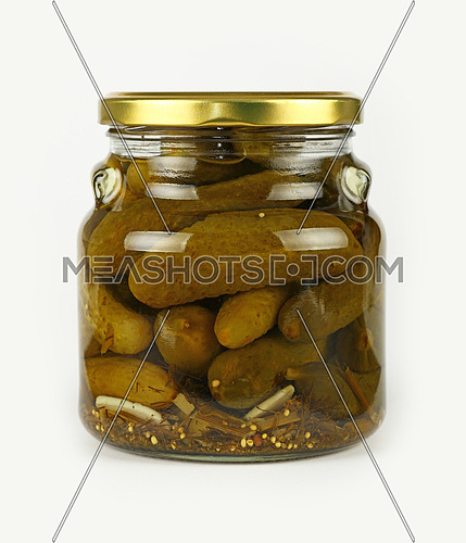 Close up of one glass jar of pickled small green gherkin cucumbers with golden lid over white background, low angle side view