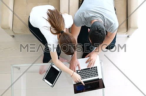Top view of couple buying things for their home online