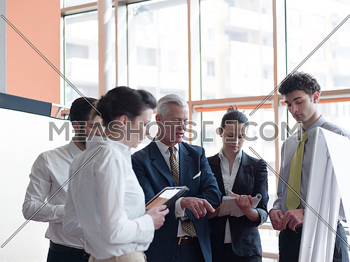business people group brainstorming on meeting and businessman presenting ideas and projects on white board to senior ceo manager