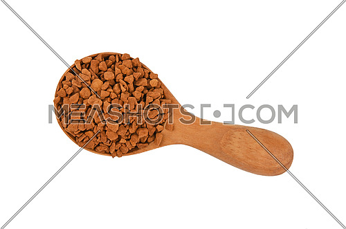 Close up wooden scoop spoon full of freeze dried instant coffee granules isolated on white background, elevated top view, directly above