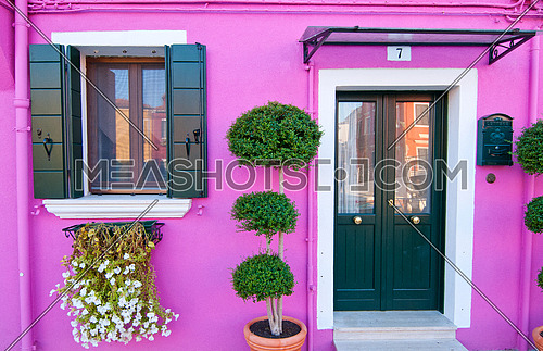 a pink house in Venice Burano island