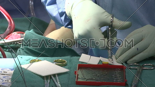 Close shot for Surgical technician hand cuts gauze pads