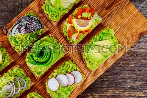 Healthy snack vegetarian sandwich with guacamole and vegetables