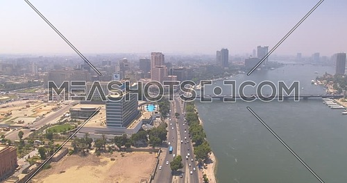 Reveal shot Drone for Cairo City showing The River Nile and Nile Ritz Carlton Hotel in Cairo Downtown at Day