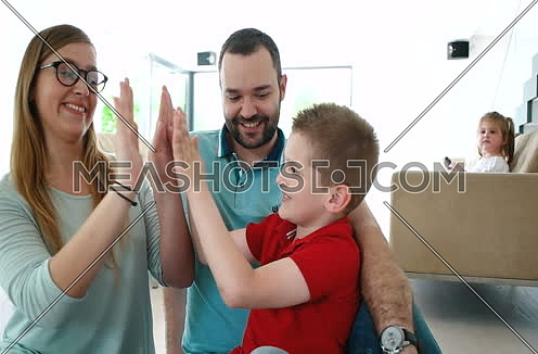 Happy family spending good time together in new home
