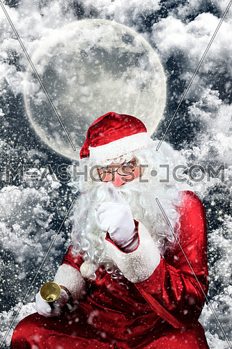 Santa Claus in the Christmas Night , with Sky full of Stars, Snow, Clouds and The Moon in the Background