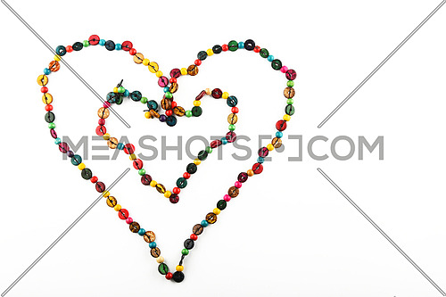 Double heart shaped colorful handmade wooden round beads necklace isolated on white