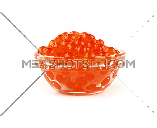 Close up glass bowl of salmon fish red caviar isolated on white background, low angle side view