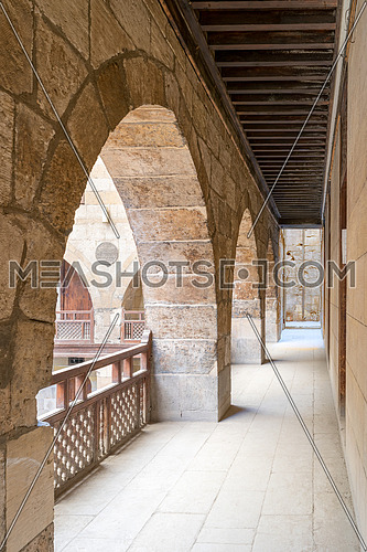Arch with interleaved wooden balustrades at the arcade surrounding the courtyard of caravansary (Wikala) of al-Ghuri, Medieval Cairo, Egypt