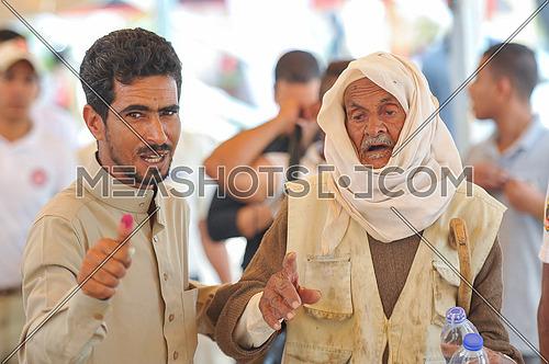 old egyption man and his son after voting in the 2018 Egyptian presidential elections in the peace city of Sharm El-Sheikh in South Sinai on the first day of the elections 26 March 2018, which lasts for 3 days