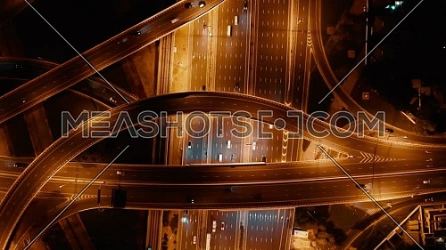 aerial top view of busy traffic on highway in Dubai at night