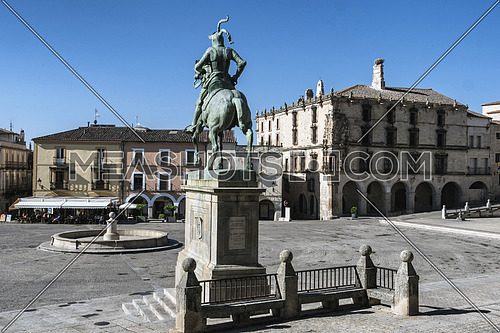 Trujillo, Spain - July 14, 2018: Equestrian statue of the conquistador Francisco Pizarro, the work of the American sculptor Charles Cary Rumsey, located on a granite pedestal in the main square of the city, Trujillo, Caceres province, Spain