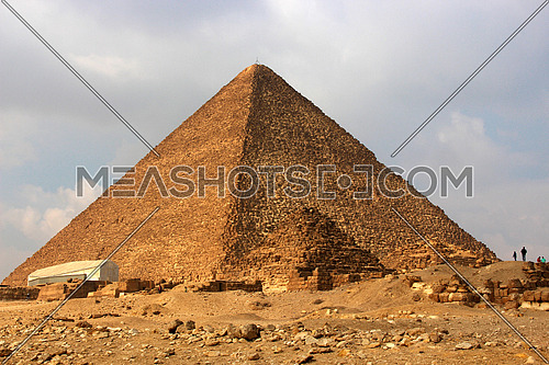 a photo showing the middle pyramid build in Giza during the pharaohs ancient civilization and the architecture style