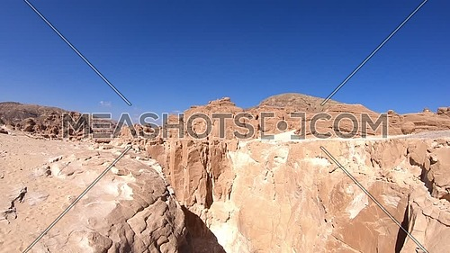Tilt up shot for White Canyon in Sinai at day