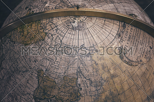 Close up background of old antique vintage earth globe map, high angle view