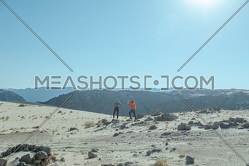 Two tourists exploring Sinai Trail from Ain Hodouda at day.