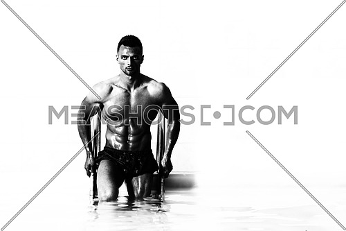 Young Healthy Good Looking Macho Man Model Athlete At Hotel Indoor Pool Isolated On White Background