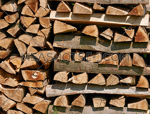 Chopped firewood on a stack. Firewood stacked and prepared for winter