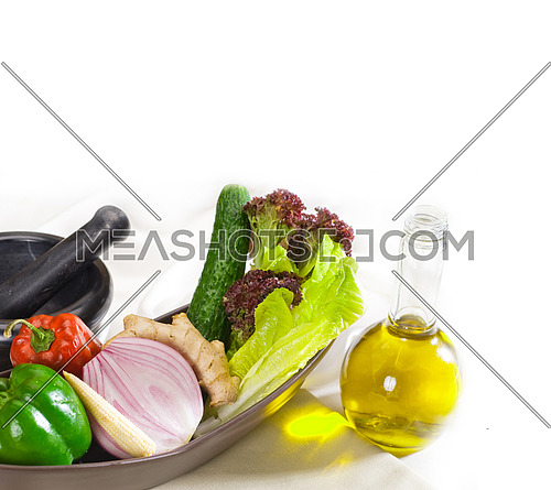 assorted fresh vegetables  and extra virgin olive oil, base for a healty diet and nutruition