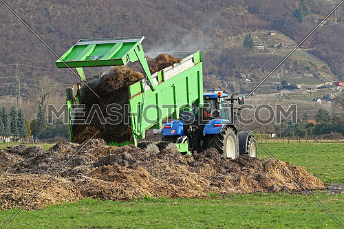 Tractor with trailer dumping manure