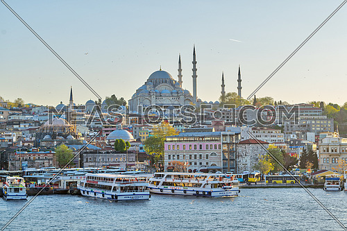 Istanbul, Turkey - April 25, 2017: Istanbul city view from Galata Bridge overlooking the Golden Horn with Eminonu (Turyol) ferry terminal and Suleymaniye Mosque before sunset