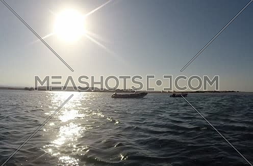 Follow shot for motorboat in the Red Sea at Day