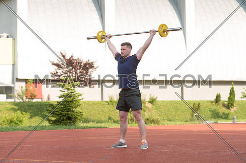 Overhead Squat Exercise Outdoor Performing By A Young Man