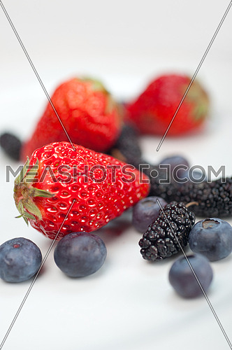 fresh and ripe strawberry mulberry and mulberry on white