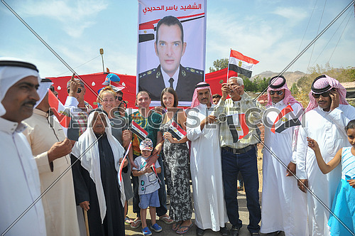 A group of tourists participating in Sinai Bedouins celebrate outside the polling center on the last day of the Egyptian presidential elections in the city of Dahab in South Sinai Governorate