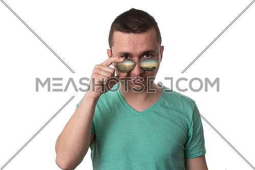 Young Man Wearing A Green T-Shirt And Sunglasses - Isolated Over White Background