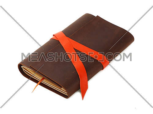 Close up of one vintage style jotter notebook with old leather cover and orange bookmark strap, isolated on white, elevated high angle view