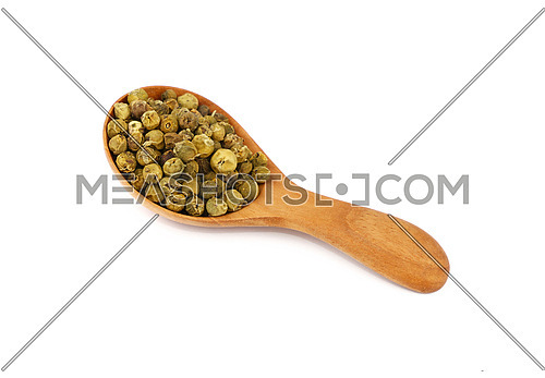 Close up one wooden scoop spoon full of green pepper peppercorns isolated on white background, high angle view