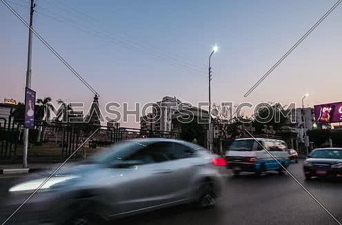Zoom IN Shot for Traffic and Le Baron Palace at Salah Salim Street from Day to Night