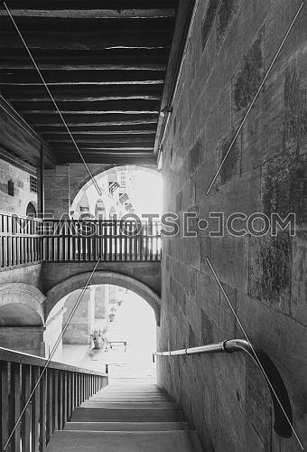 Staircase going down with wooden balustrade at caravansary - Wikala - of Bazaraa, suited in Gamalia district, Medieval Cairo, Egypt