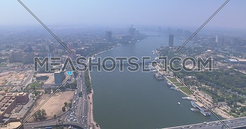 Fly over shot Drone for Cairo City showing The River Nile,Traffic and Bridges in Cairo Downtown at Day