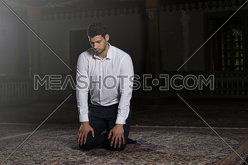 Adult Muslim Man Is Praying In The Mosque