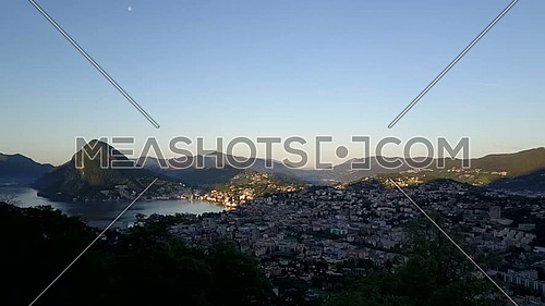 Aerial view of Lugano and its bay on Lake Ceresio at first lights of dawn