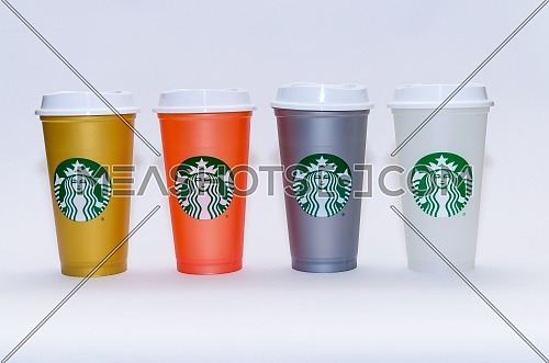 4 different colors of Starbucks, gold , orange, grey and white. December 2018 in Cairo - Egypt