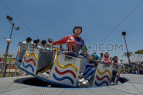 young people on an amusement park ride during eid al fitr celebration july 7 2016