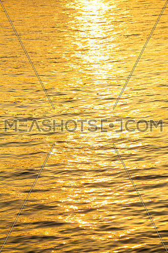 Sun reflection out of golden river
