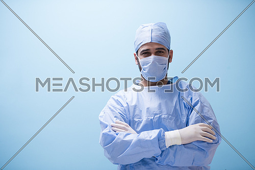 Portrait of a young middle eastern doctor with gloves on his hands in the modern clinic