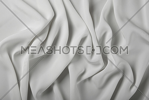 Close up abstract textile background of white folded pleats of fabric, elevated top view, directly above