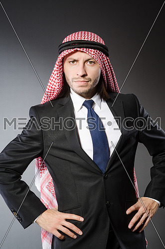 Arab businesssman against grey background